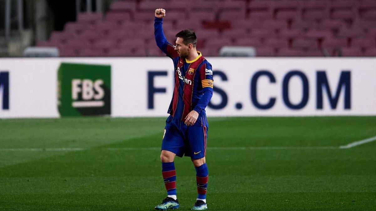Lionel Messi celebrates after scoring the opening goal during the La Liga Santander match between FC Barcelona and Athletic Club at Camp Nou on January 31, 2021 i