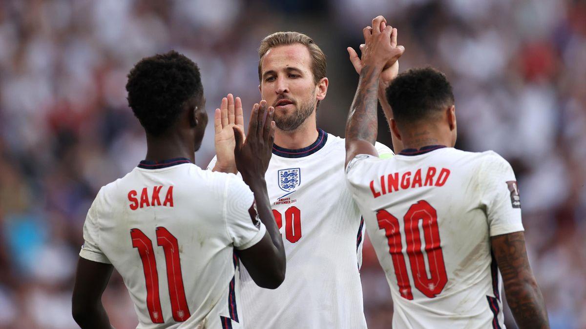 Harry Kane of England celebrates with Bukayo Saka and Jesse Lingard