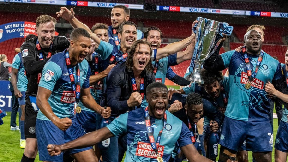 Wycombe Wanderers' players celebrate victory and promotion to the Sky Bet Championship