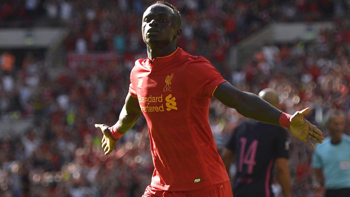 Liverpool's Sadio Mane celebrates after scoring their first goal v Barcelona