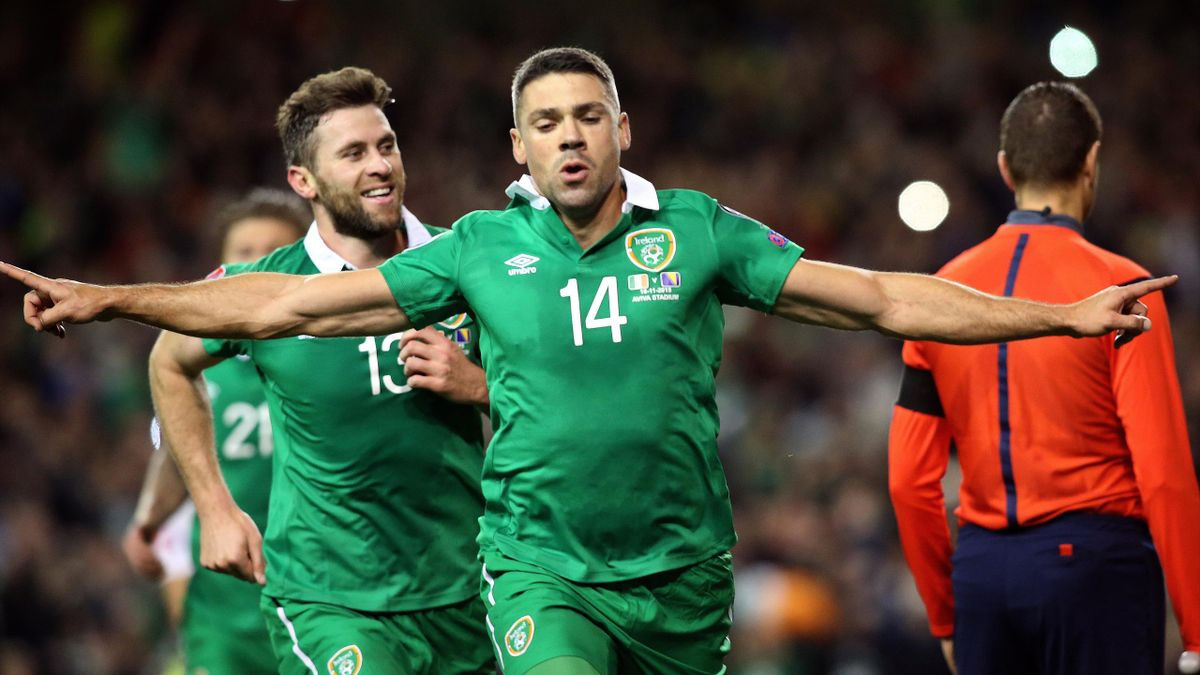 reland's striker Jonathan Walters (C) celebrates after scoring his team's first goal from a penalty during a UEFA Euro 2016 Group D qualifying second leg play-off football match between Ireland and Bosnia Herzegovina at the Aviva stadium in Dublin on Nove