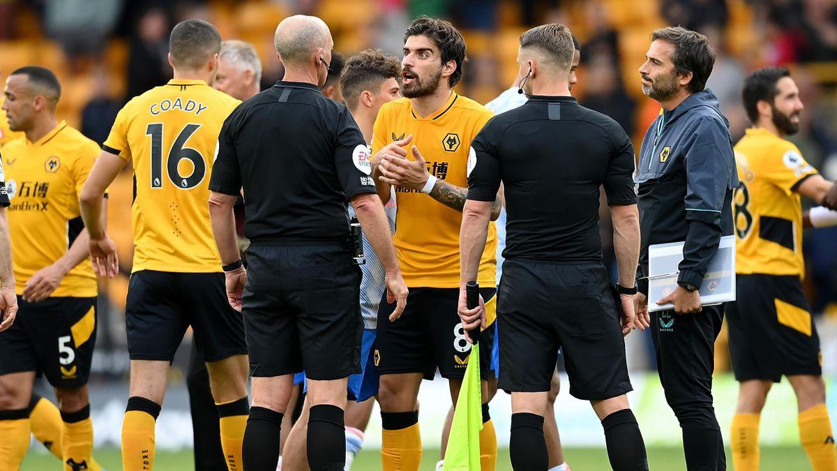 Wolves' Ruben Neves talks to Mike Dean, Wolves v Manchester United, Premier League, Molineux. Wolverhampton, August 29. 2021