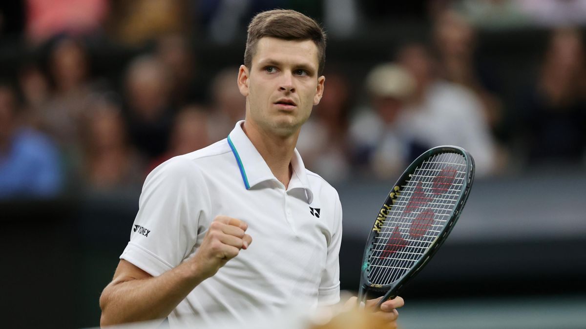 Hubert Hurkacz of Poland celebrates in his Men's Singles Fourth Round match against Daniil Medvedev of Russia during Day Eight of The Championships