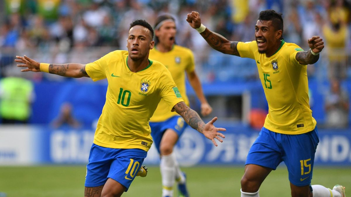 Brazil's forward Neymar (L) celebrates after scoring the opening goal
