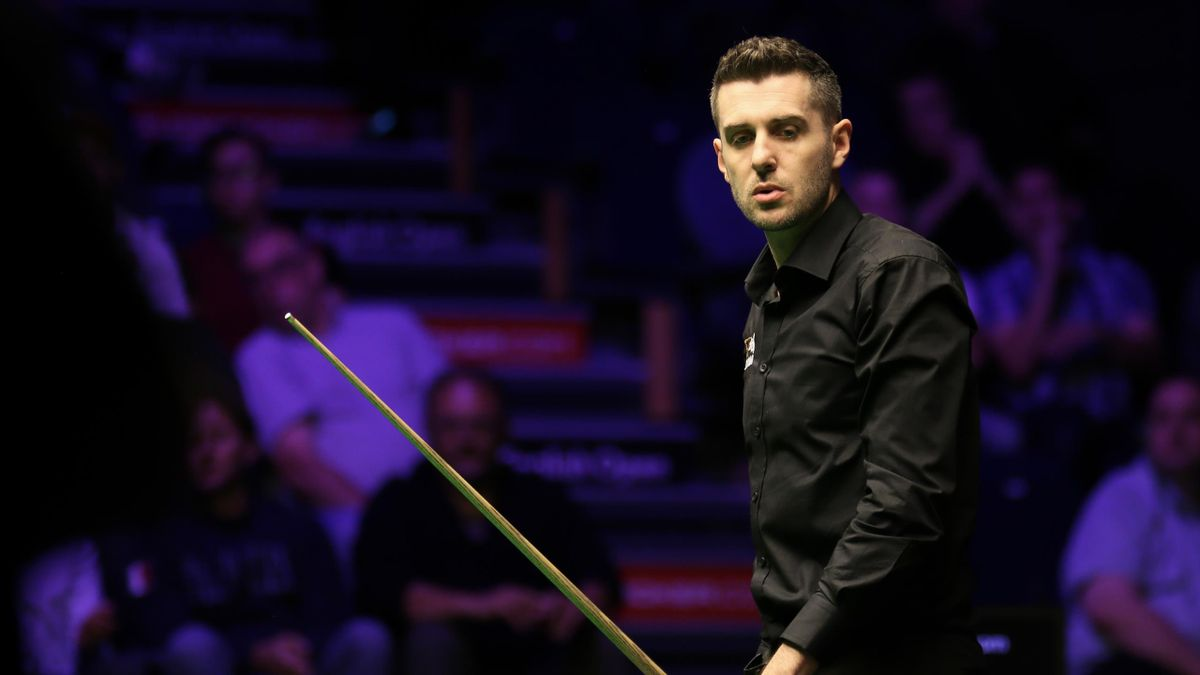 Mark Selby of England reacts in the semi-final match against Mark Allen of Northern Ireland on day six