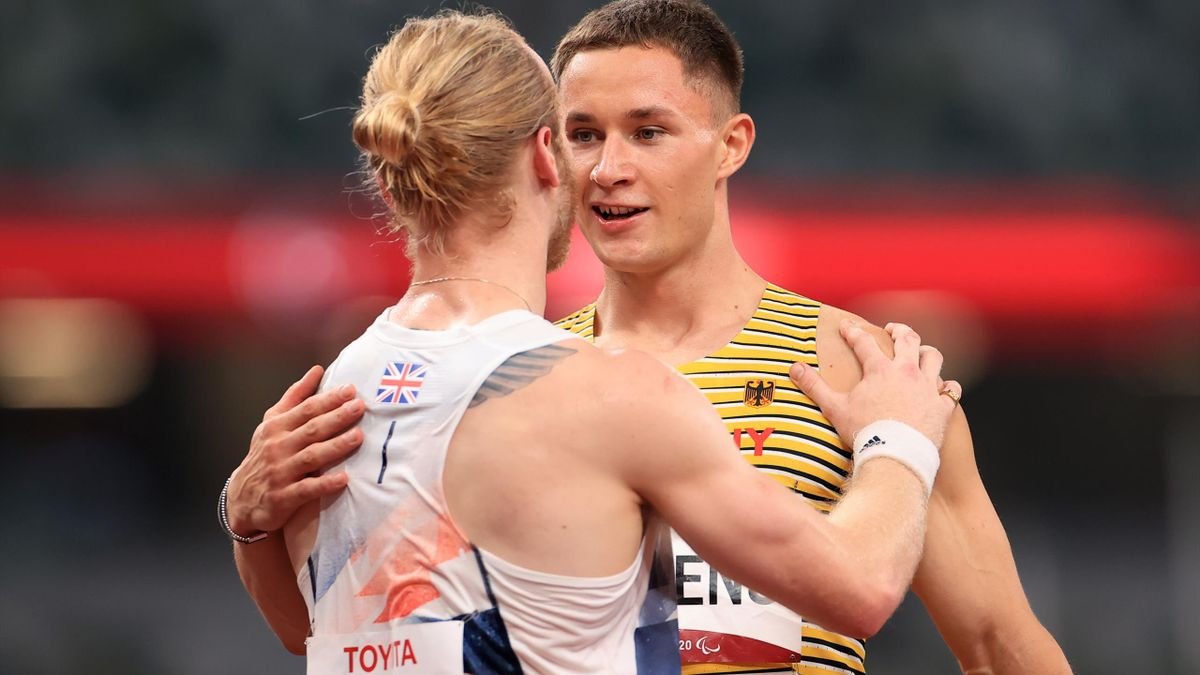 Gold medalist Felix Streng of Team Germany and bronze medalist Jonnie Peacock of Team Great Britain react after competing in the men's 100m - T64 final on day 6 of the Tokyo 2020 Paralympic Games at Olympic Stadium on August 30, 2021.