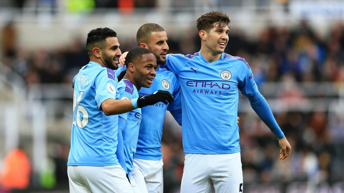 Raheem Sterling of Manchester City celebrates with teammates Riyad Mahrez, Kyle Walker and John Stones after scoring his team's first goal during the Premier League match between Newcastle United and Manchester City at St. James Park