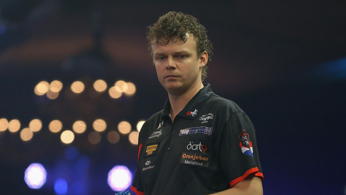 Richard Veenstra of the Netherlands reacts during his First Round match against Kyle McKinstry of the BDO World Darts Championship at Lakeside Country Club on January 9, 2018 in Camberley, England.