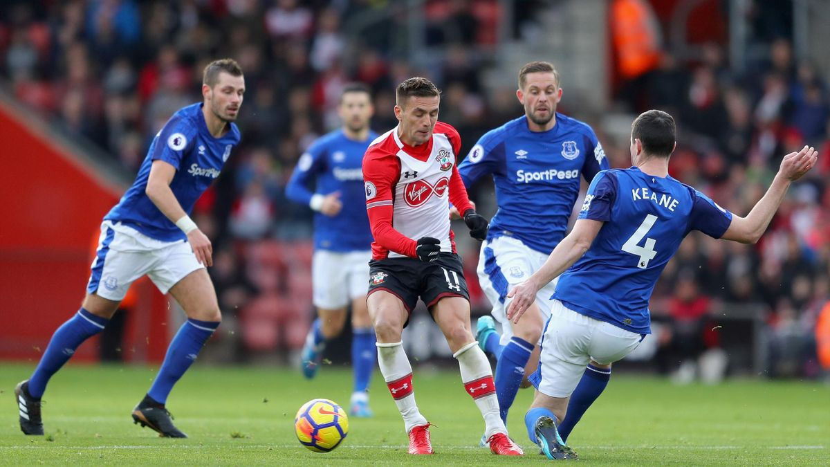 Dusan Tadic of Southampton is tackled by Michael Keane of Everton as Gylfi Sigurdsson of Everton looks on
