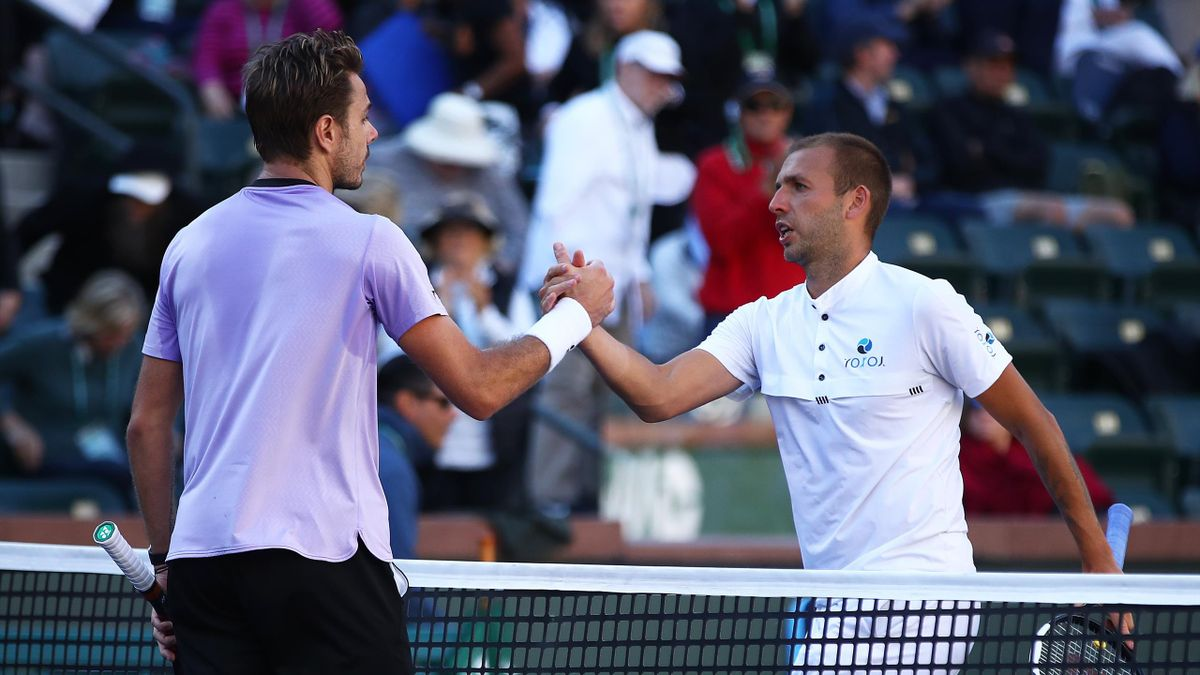 Dan Evans of Great Britain shakes hands at the net after his three set defeat against Stan Wawrinka of Switzerland
