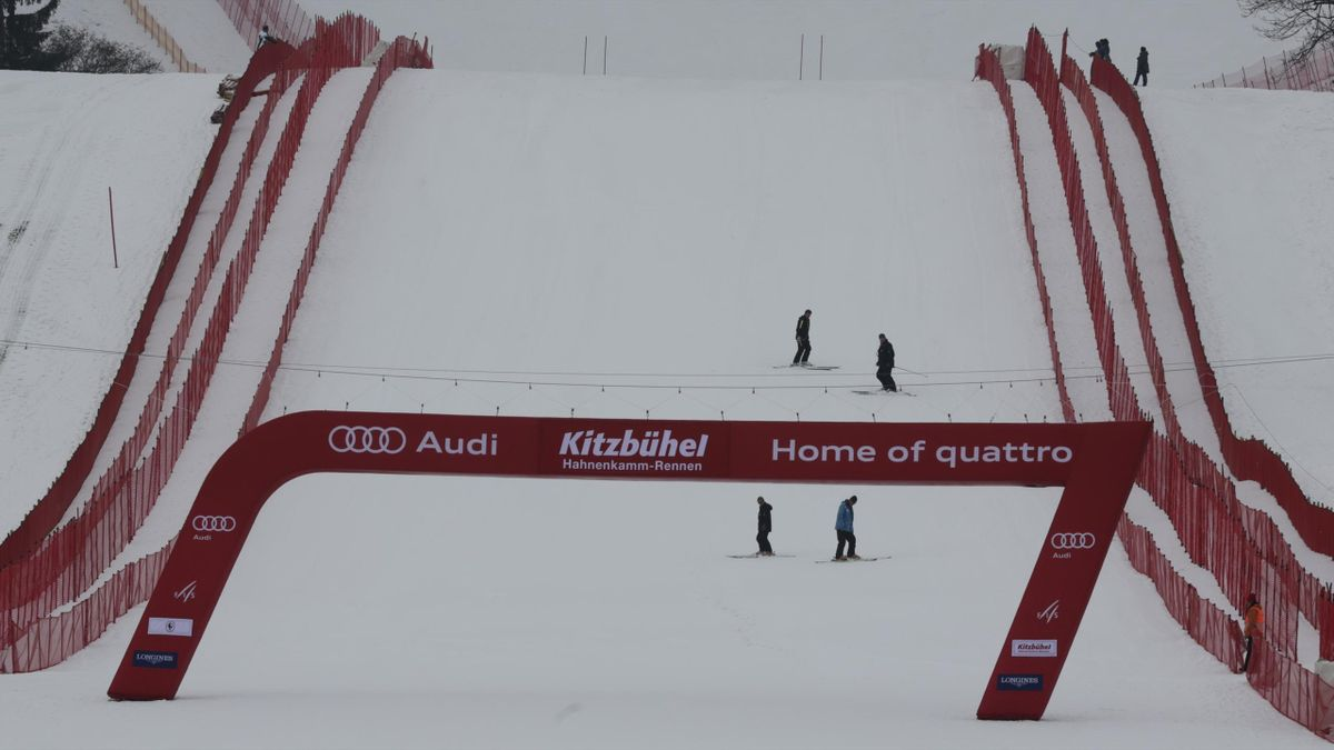Slope workers on the famous 'Die Streif', the men's Alpine skiing downhill course, at the Hahnenkamm mountain of the Austrian Alpine skiing resort of Kitzbuehel