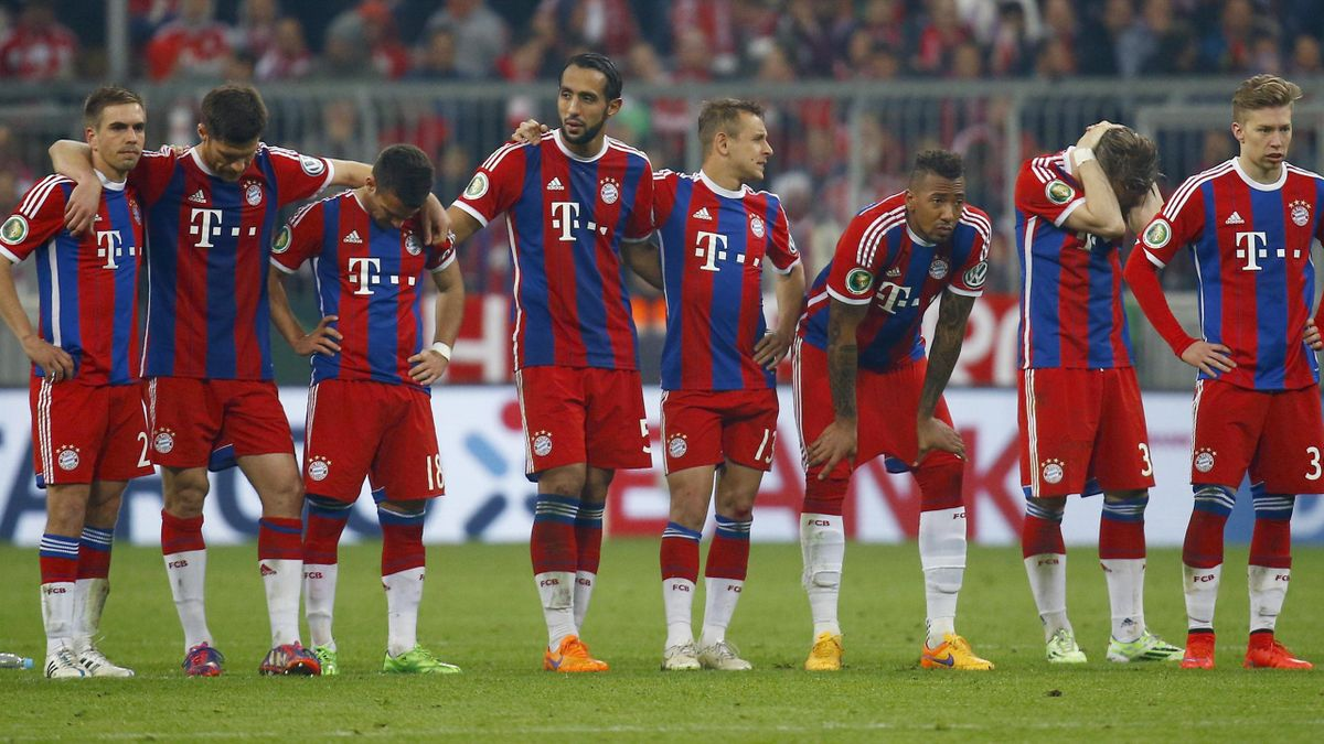 Bayern Munich players watch as penalties are taken after extra time in the German Cup (DFB Pokal) semi-final soccer match against Borussia Dortmund