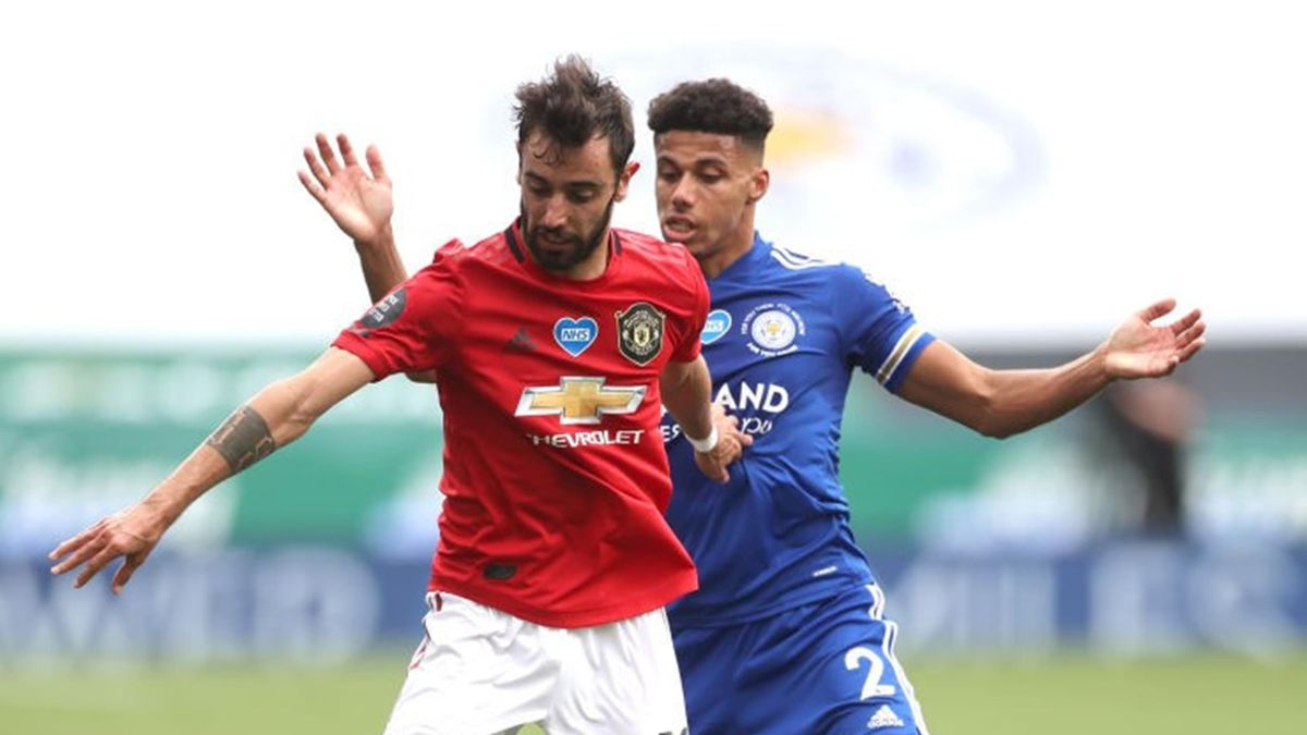 Bruno Fernandes of Manchester United is tackled by James Justin of Leicester City during the Premier League match between Leicester City and Manchester United at The King Power Stadium on July 26, 2020 in Leicester
