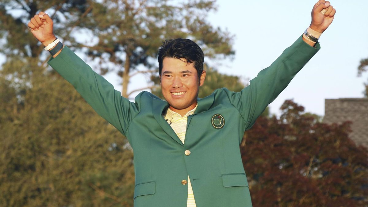 Japanese golfer Hideki Matsuyama celebrates with the champion's green jacket after winning the Masters Tournament on 11 April, 2021, at Augusta National Golf Club in Augusta, Georgia.