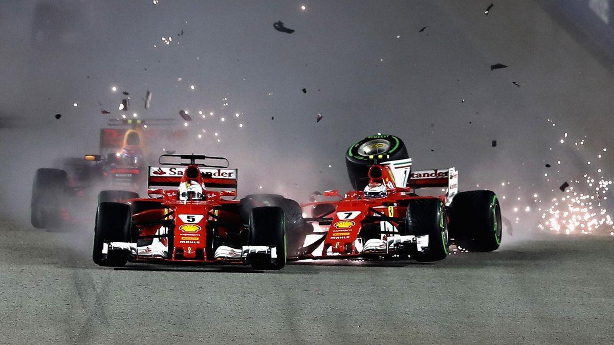 Sebastian Vettel of Germany driving the (5) Scuderia Ferrari SF70H and Kimi Raikkonen of Finland driving the (7) Scuderia Ferrari SF70H collide at the start during the Formula One Grand Prix of Singapore at Marina Bay Street Circuit