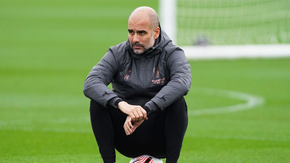 Pep Guardiola, manager of Manchester City looks on during the training session at Manchester City Football Academy
