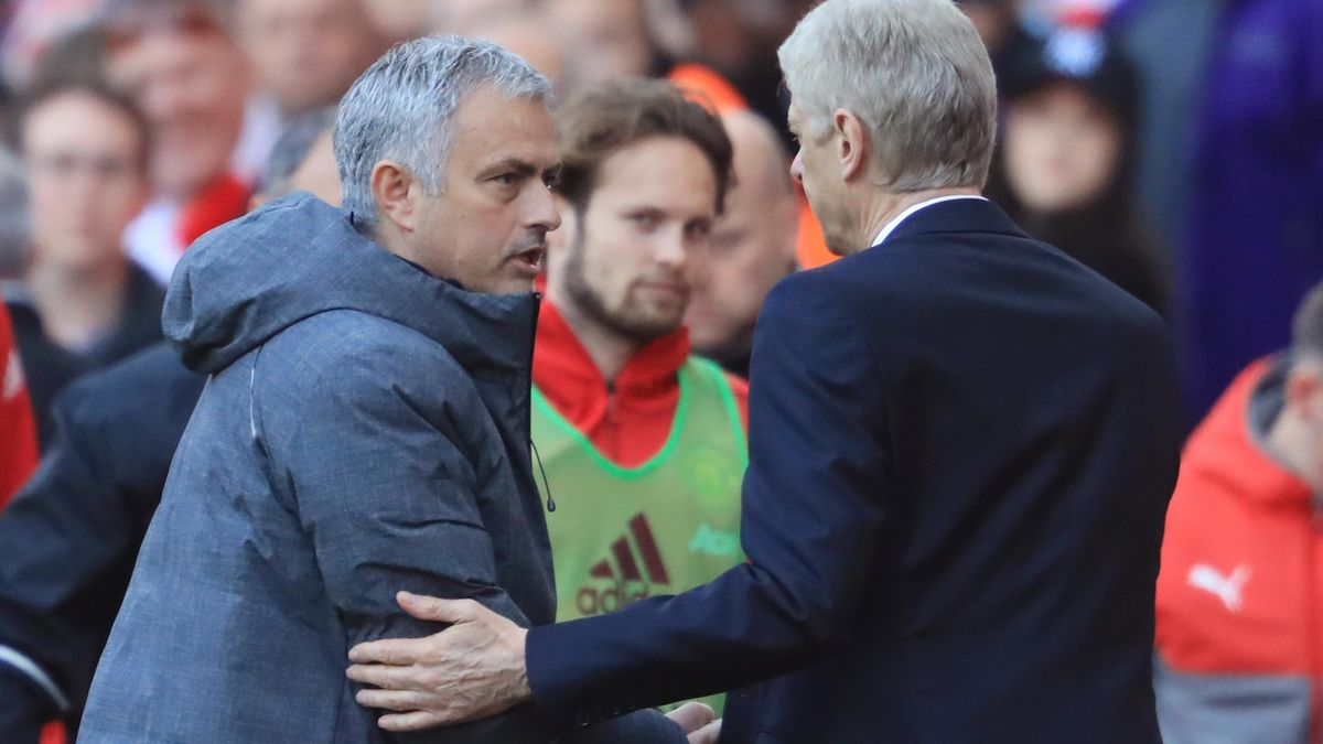 Jose Mourinho, Manager of Manchester United and Arsene Wenger, Manager of Arsenal shake hands