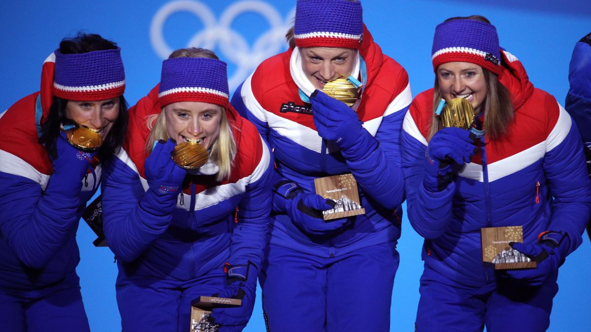 Gold medalists Ingvild Flugstad Oestberg, Astrid Uhrenholdt Jacobsen, Ragnhild Haga and Marit Bjoergen of Norway celebrate during the medal ceremony for the Cross-Country Skiing - Ladies' 4x5km Relay on nine one of the PyeongChang 2018 Winter Olympic Game