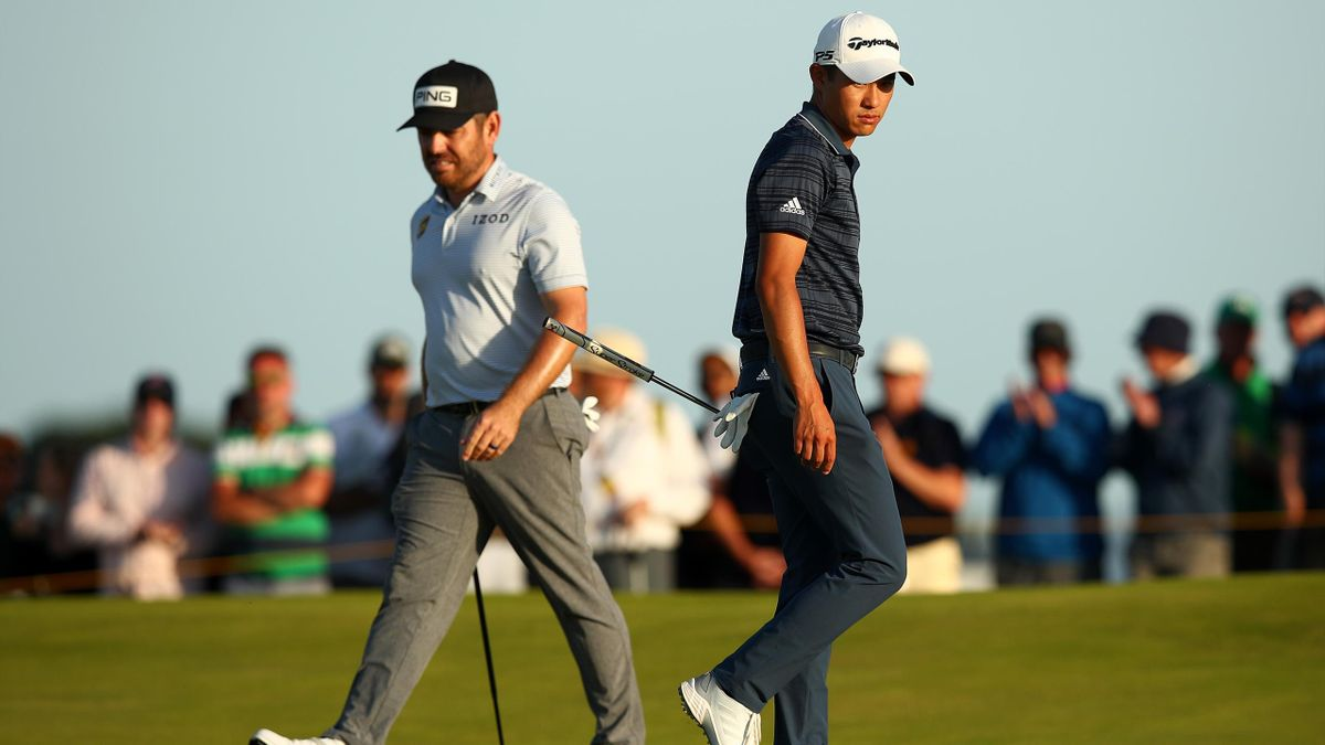 Louis Oosthuizen of South Africa and Collin Morikawa of the United States walk across the 17th green during Day Three of The 149th Open at Royal St George's Golf Club on July 17, 2021 in Sandwich, England.