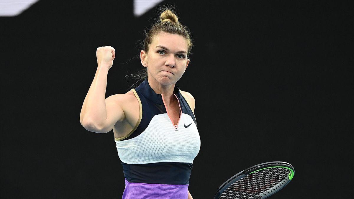 Simona Halep of Romania celebrates beating Lizette Cabrera of Australia during day one of the 2021 Australian Open