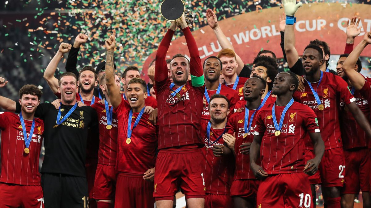 Liverpool celebrate with the Club World Cup trophy