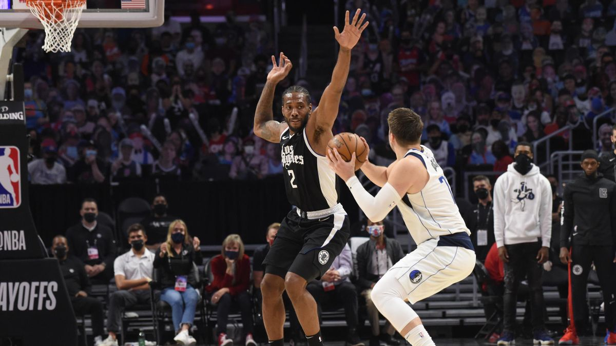 Kawhi Leonard #2 of the LA Clippers plays defense on Luka Doncic #77 of the Dallas Mavericks during Round 1, Game 7 of the 2021 NBA Playoffs on June 6, 2021 at STAPLES Center in Los Angeles,