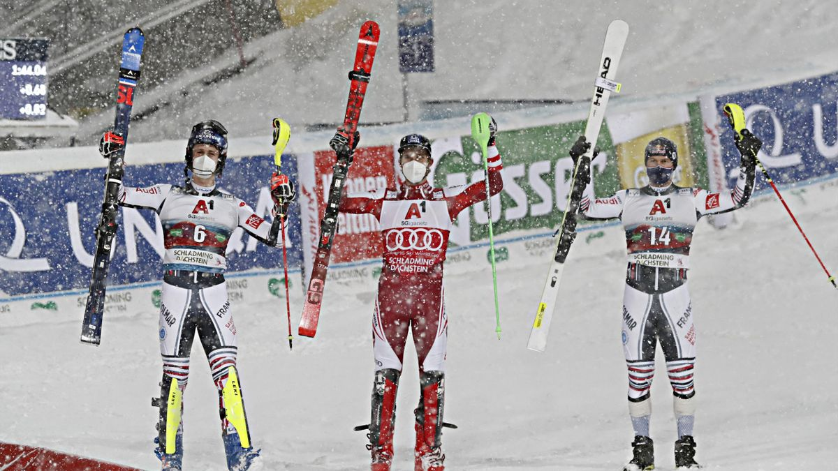 Clement Noel of France takes 2nd place, Marco Schwarz of Austria takes 1st place, Alexis Pinturault of France takes 3rd place during the Audi FIS Alpine Ski World Cup Men's Slalom on January 26, 2021 in Schladming Austria. (