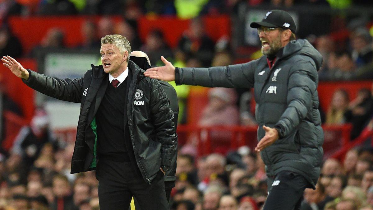 Manchester United's Norwegian manager Ole Gunnar Solskjaer (L) and Liverpool's German manager Jurgen Klopp