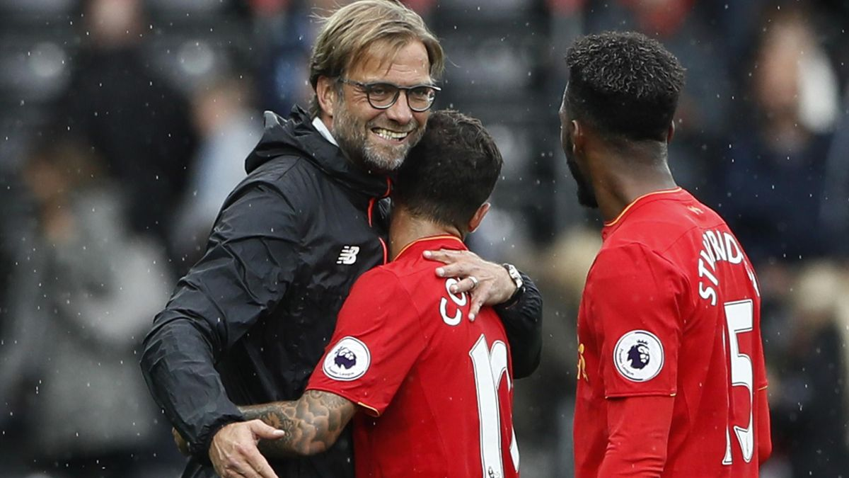 Liverpool manager Juergen Klopp celebrates with Philippe Coutinho and Daniel Sturridge at the end of the match.