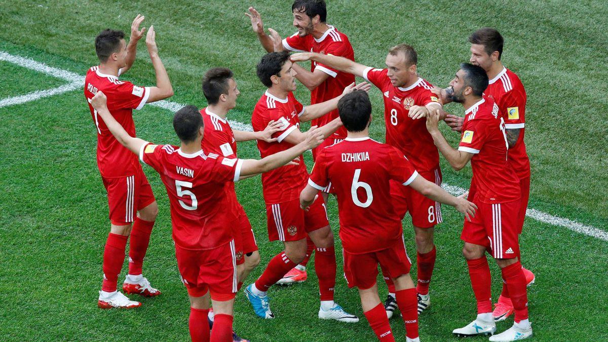 Russia's Denis Glushakov celebrates scoring their first goal