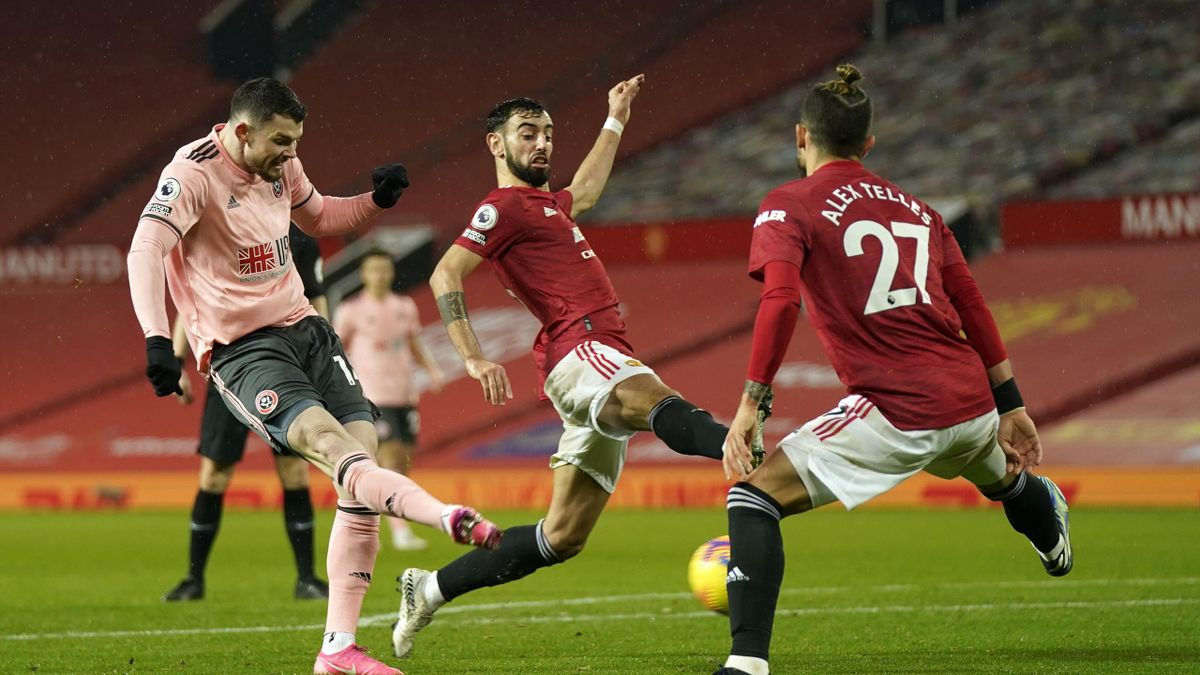 Oliver Burke of Sheffield United scores their sides second goal during the Premier League match between Manchester United and Sheffield United at Old Trafford on January 27, 2021 in Manchester, England.
