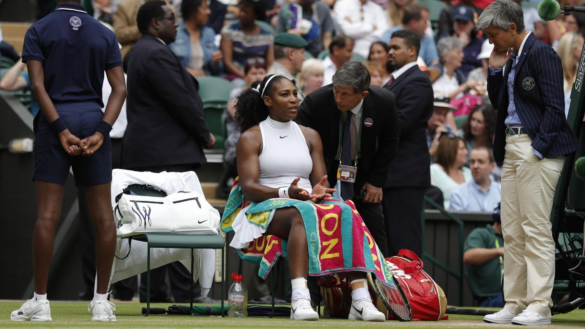 Serena Williams talks to the umpire and officials after slipping during her match against Russia's Svetlana Kuznetsova.