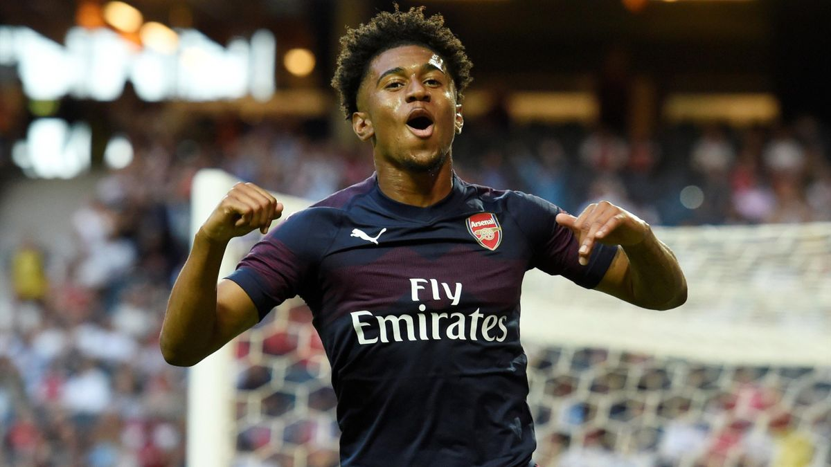 Arsenal's Reiss Nelson celebrates scoring their first goal.