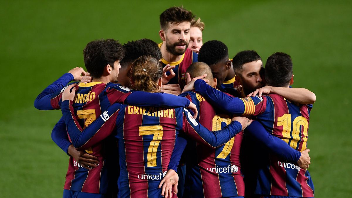 Barcelona players celebrate their third goal scored by Barcelona's Danish forward Martin Braithwaite during Spanish Copa del Rey (King's Cup) semi-final second leg football match between FC Barcelona and Sevilla FC at the Camp Nou stadium in Barcelona on