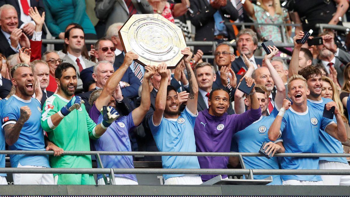 FA Community Shield - Manchester City v Liverpool - Wembley Stadium, London, Britain - August 4, 2019 Manchester City's Sergio Aguero and David Silva celebrate winning the FA Community Shield with team mates