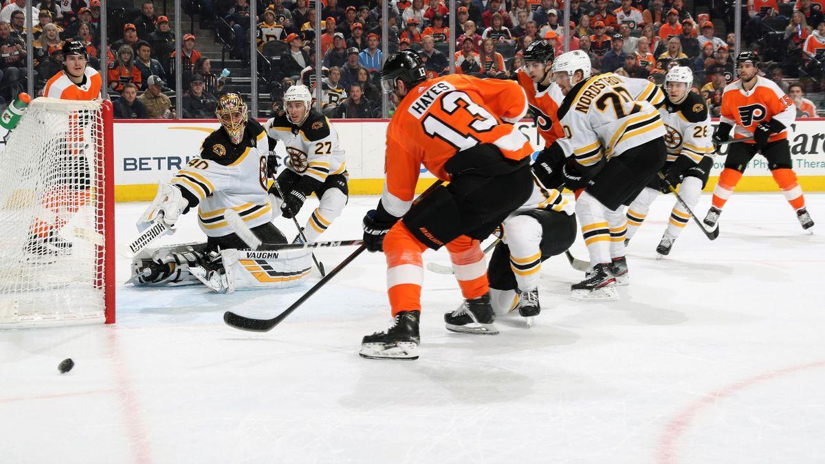 Tuukka Rask #40, John Moore #27, Ondrej Kase #28 and Joakim Nordstrom #20 of the Boston Bruins react to a shot on goal by Kevin Hayes #13 and Derek Grant #38 of the Philadelphia Flyers on March 10, 2020 at the Wells Fargo Center in Philadelphia, Pennsylva