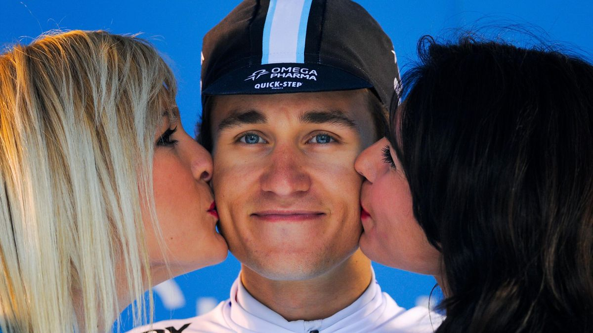Michal Kwiatkowski of Poland and Team Omega Phama Quick-Step smiles as he gets a kiss on each cheek on the final podium after claiming second in the general classification following Stage Six of Vuelta al Pais Vasco on April 12, 2014