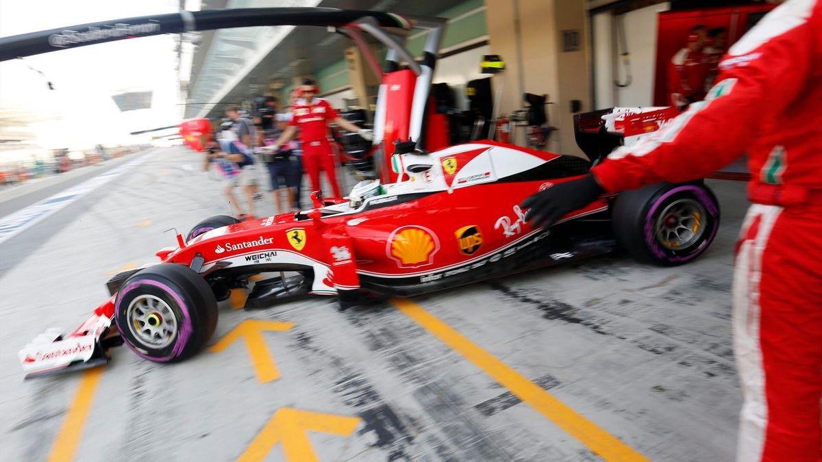 Ferrari's Sebastian Vettel exits the pits