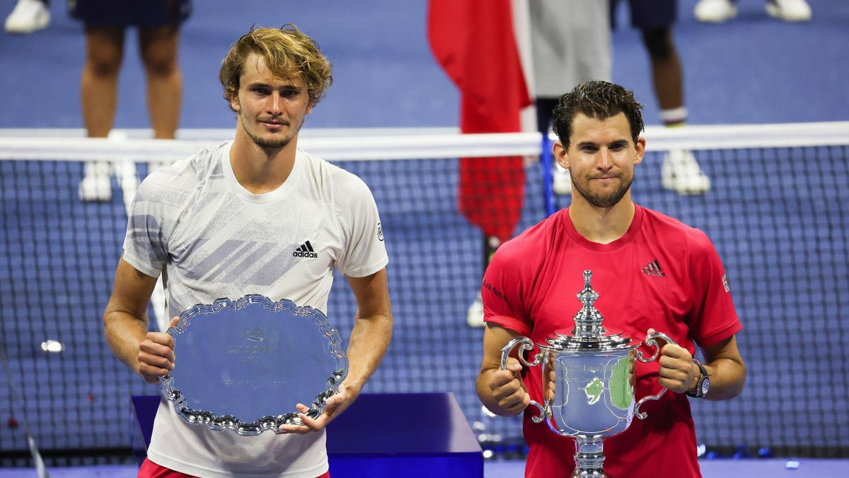 Alexander Zverev of Germany celebrates with his finalist trophy alongside Dominic Thiem of Austria with his championship trophy after Thiem won in a tie-breaker during their Men's Singles final match on Day Fourteen of the 2020 US Open