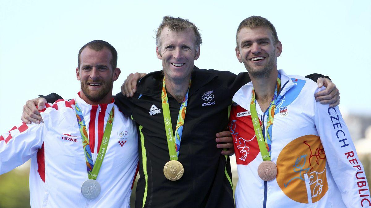 Gold medalist Mahe Drysdale (NZL) of New Zealand, silver medalist Damir Martin (CRO) of Croatia and bronze medalist Ondrej Synek (CZE) of Czech Republic