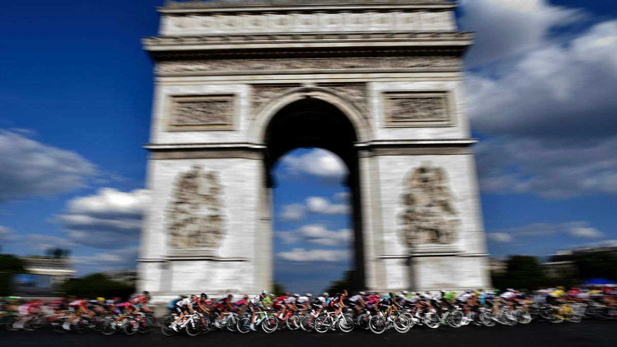 The pack rides in front of the Arc de Triomphe (Arch of Triumph) during the 113 km twenty-first and last stage of the 103rd edition of the Tour de France cycling race on July 24, 2016 between Chantilly and Paris Champs-Elysees.
