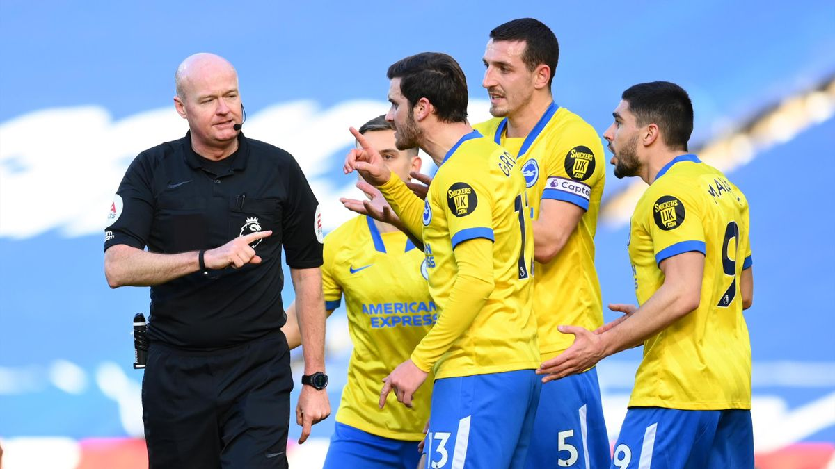 Pascal Gross, Lewis Dunk, and Neal Maupay of Brighton confront referee Lee Mason, West Bromwich Albion and Brighton & Hove Albion, Premier League, The Hawthorns, February 27, 2021