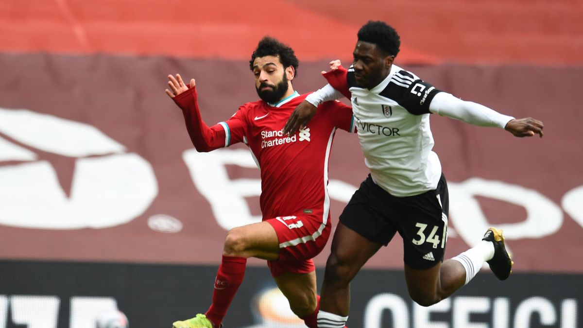Mohamed Salah of Liverpool With Ola Aina of Fulham during the Premier League match between Liverpool and Fulham at Anfield
