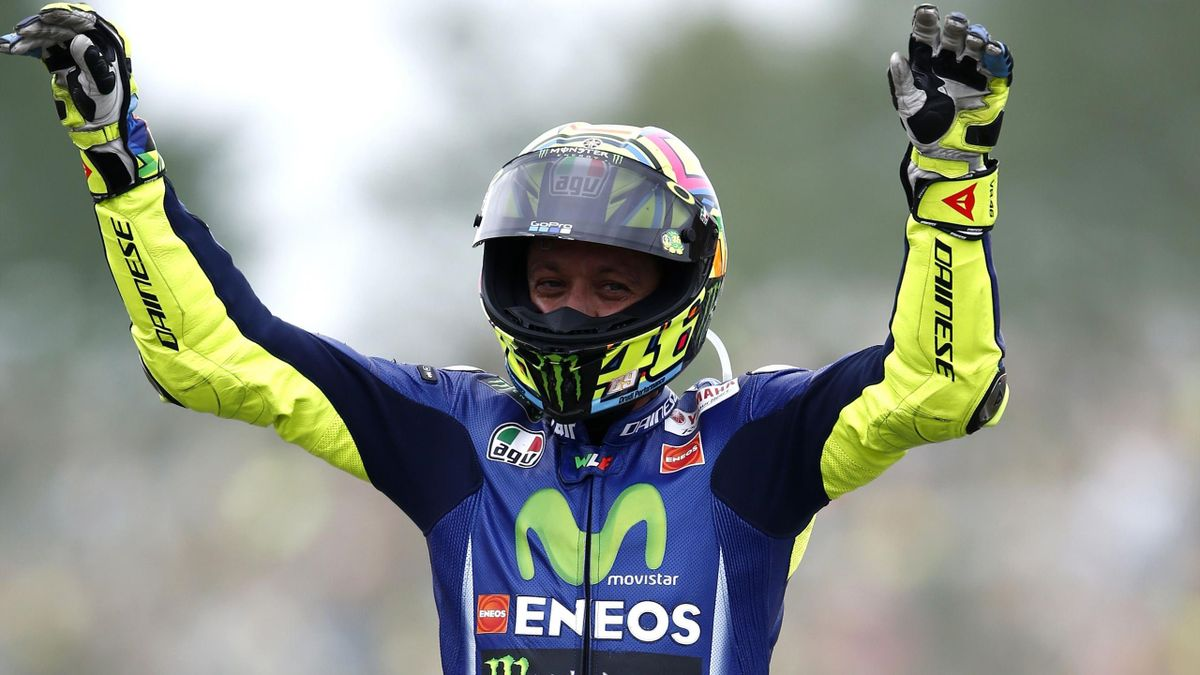 Italy's Valentino Rossi celebrates after winning the Assen Motorcycling Grand Prix at the TT circuit in Assen