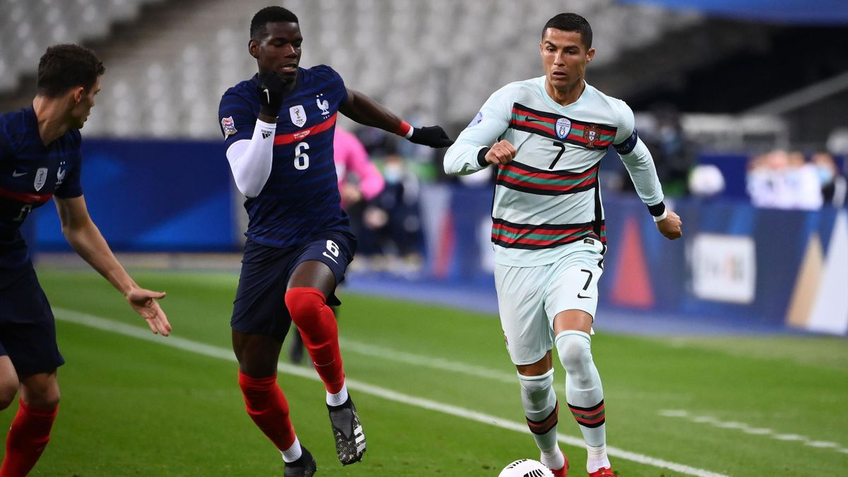 Portugal's forward Ronaldo (R) vies with France's midfielder Paul Pogba during of the Nations League football match between France and Portugal, on October 11, 2020 at the Stade de France in Saint-Denis, outside Paris