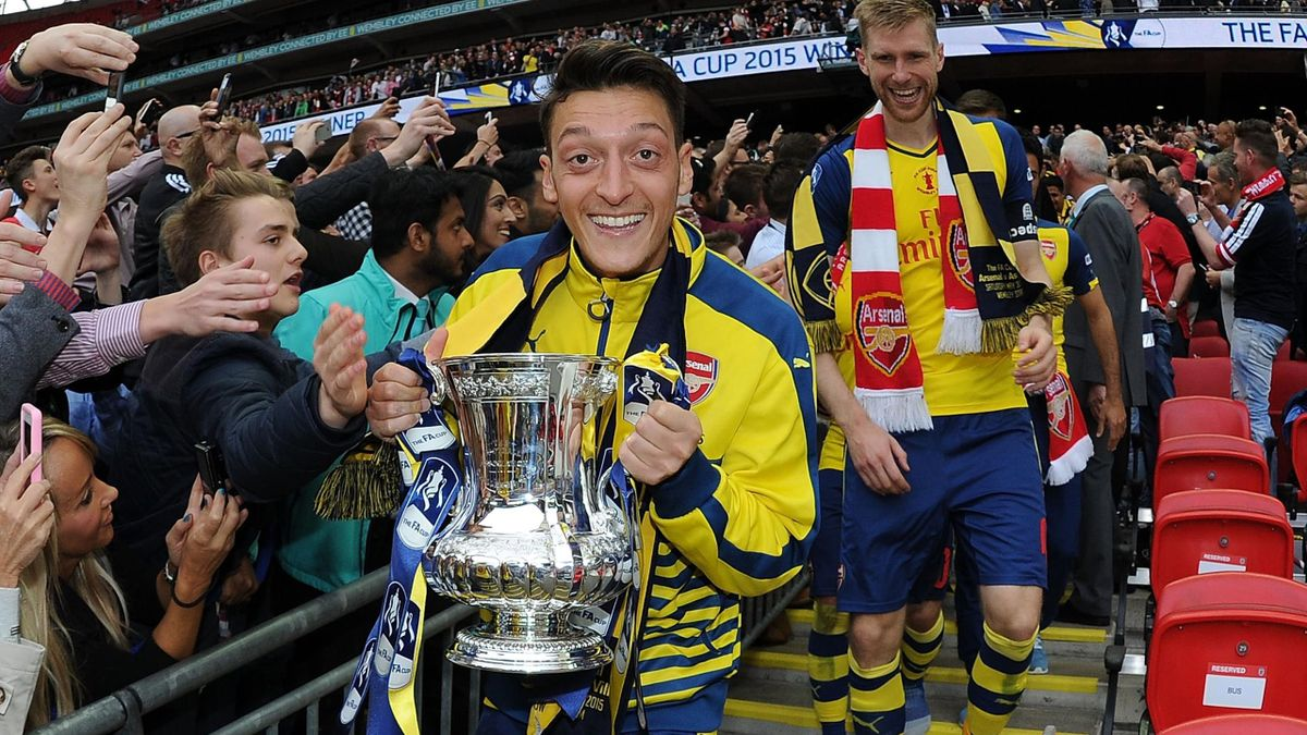 Arsenal's Mesut Ozil celebrates after the FA Cup Final between Aston Villa and Arsenal at Wembley Stadium on May 30, 2015 in London, England.