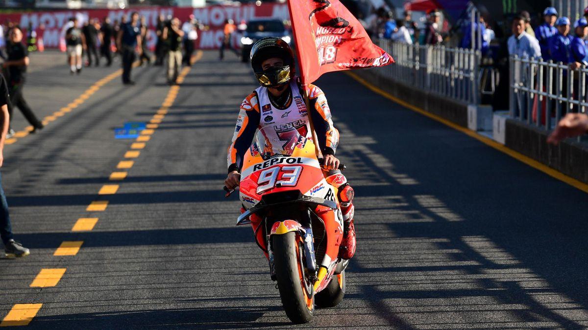 Repsol Honda Team Spanish rider Marc Marquez arrives in the pits of the MotoGP Japanese Grand Prix at Twin Ring Motegi circuit in Motegi, Tochigi prefecture on October 21, 2018