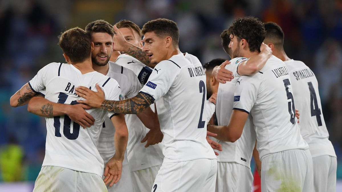 ROME, ITALY - JUNE 11: Domenico Berardi of Italy celebrates with team mates after their side's first goal, an own goal scored by Merih Demiral (Not pictured) of Turkey during the UEFA Euro 2020 Championship Group A match between Turkey and Italy at the St