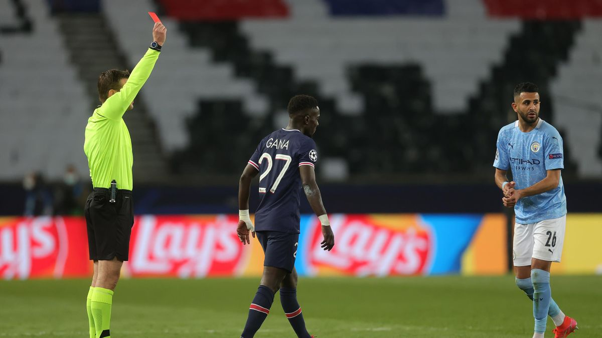 Idrissa Gueye of Paris Saint-Germain is shown a red card by Referee Felix Brych during the UEFA Champions League Semi Final First Leg match between Paris Saint-Germain and Manchester City at Parc des Princes on April 28, 2021 in Paris,