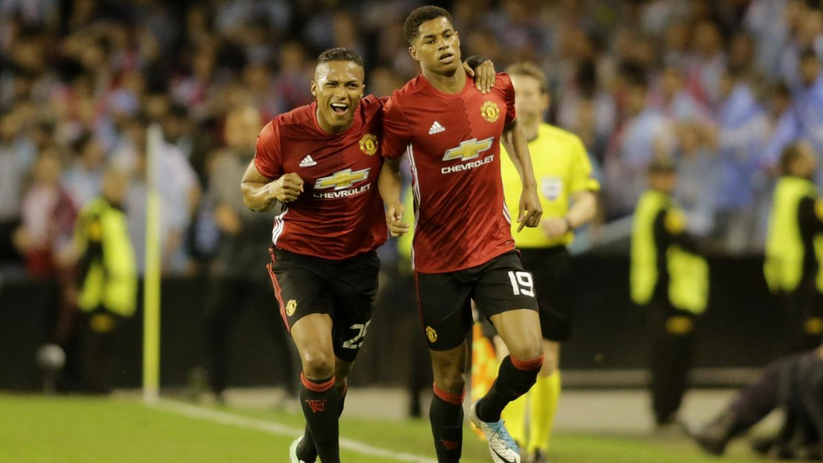 Manchester United's Marcus Rashford celebrates scoring their first goal with Antonio Valencia Reuters